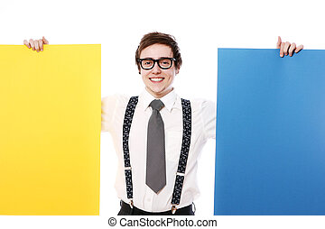 Stylish businessman with colorful billboards