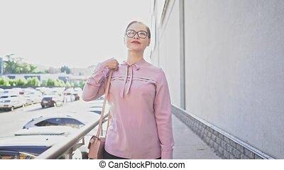 Stylish businesswoman outside on city street - Elegant Asian...