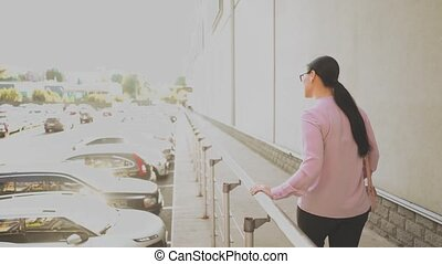 Stylish businesswoman outside on city street - Walking...