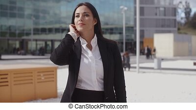 Stylish businesswoman waiting for someone