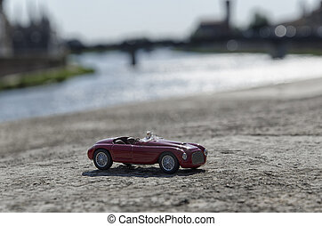 Stylish car with Pisa on the background