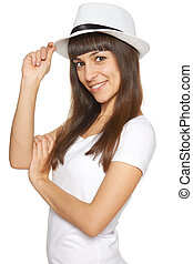 Stylish casual young woman posing with a hat