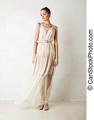 Stylish caucasian girl in white dress posing