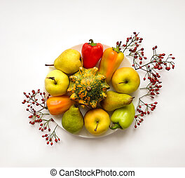 Stylish composition of vegetables, fruits, autumn berries. Top view on white background. Autumn flat lay