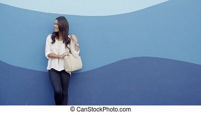 Stylish Cool Girl Against A Blue Wall