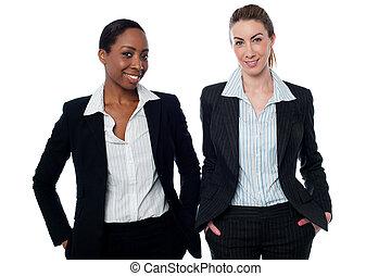Stylish corporate women posing casually