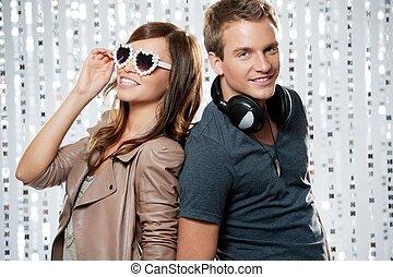 Stylish couple in a night club.