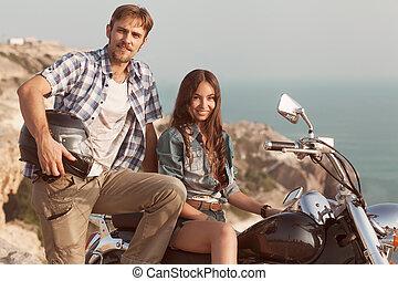Stylish couple on a motorcycle. He