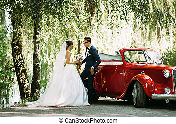Stylish couple under tree in the wedding day
