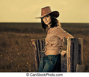 cowgirl  - stylish cowgirl at wooden fence