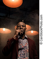 african american man smoking cigar