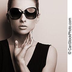 Stylish fashion female model in fashion sunglasses posing. ...