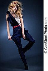 Stylish fashion model posing in blue leggings