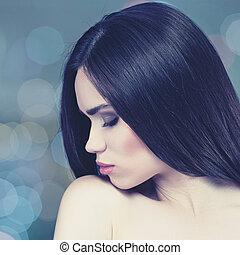 Stylish fashionable female portrait with beauty bokeh