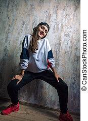 stylish female street dancer posing to the camera