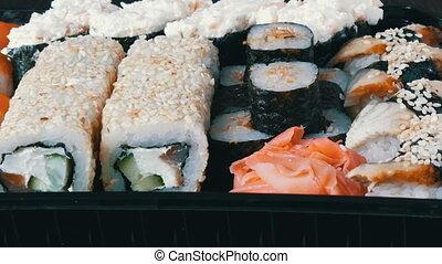 Stylish fresh sushi set with various kinds of sushi rolls,...