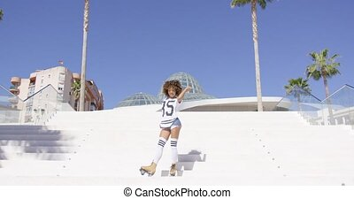 Stylish girl dancing on stairs - Young stylish female in...