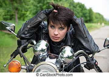 Stylish girl on a bike