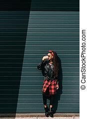 stylish girl with coffee to go