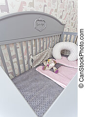 Stylish grey baby cot with toy - Stylish grey baby cot with ...