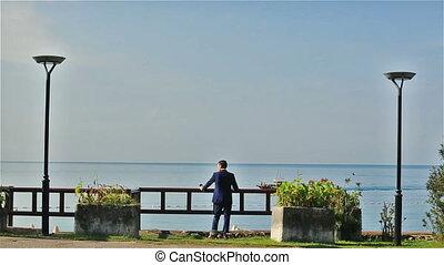 Stylish groom enjoying the view of Montenegro, Budva