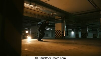 Stylish guy freerunner doing a series of jumps, somersaults...