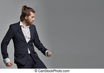 Stylish guy with beard wearing suit