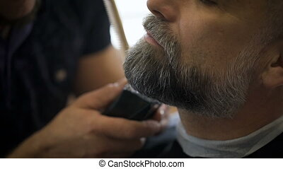 Stylish hair salon, barber Empozantny engaged beard...