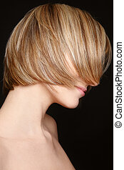 Stylish haircut - Young blond woman with stylish colored ...