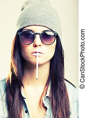 Stylish hipster teenage girl with cigarette