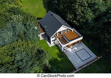 Stylish house with cobblestone driveway