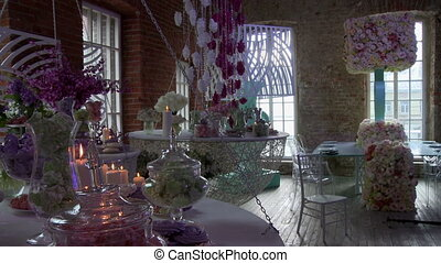 Stylish interior of cafe decorated with flowers
