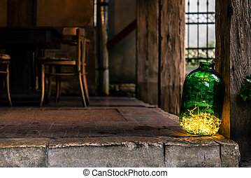 stylish jar with christmas garland lights, celebration decoration for holidays in the city