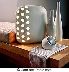 Stylish lamp on a table - Stylish lamp and ceramic bottles ...