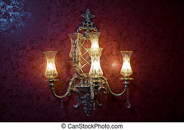 Stylish lamp on the wallpaper . Wall light of gilded metal with two electric candles . vintage wall lamp isolated on white with clipping path - Image