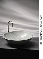 Round shaped, stylish lavabo in a bathroom.