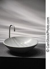 Round shaped, stylish lavabo in a bathroom.