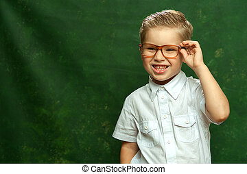 Stylish little boy in white shirt and glasses