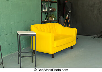 Stylish living room interior with comfortable yellow sofa
