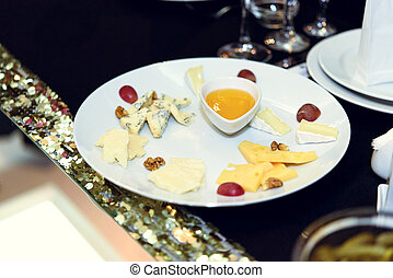 stylish luxury decorated tables with cheese appetizer for birthday celebration, cathering in the restaurant