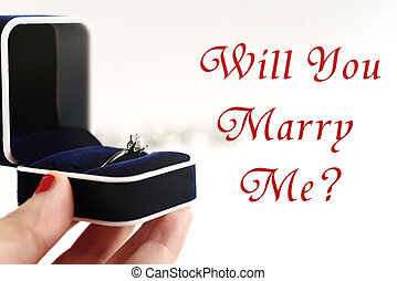 stylish luxury ring in hand, will you marry me text, greeting card concept