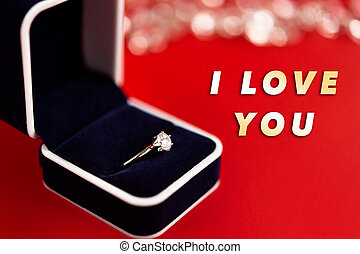 stylish luxury ring with diamond, i love you text, greeting card concept