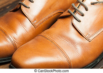 Stylish male shoes - Men's leather shoes on a wooden floor