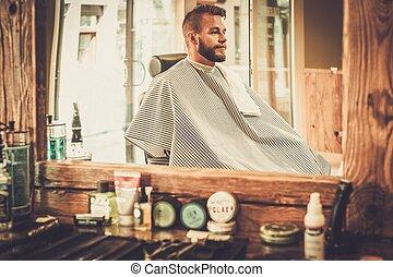 Stylish man in a barber shop
