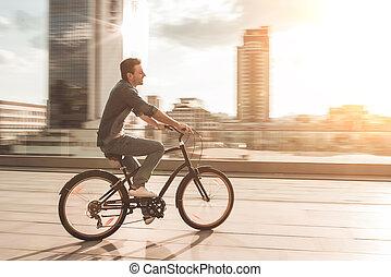 Stylish man on bicycle