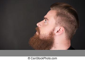 Stylish man with beard looking up - Profile of stylish young...