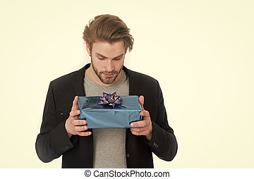 stylish man with gift box or present for christmas