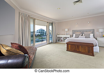stylish master bedroom in australian mansion