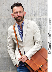Stylish mature man with leather shoulder bag