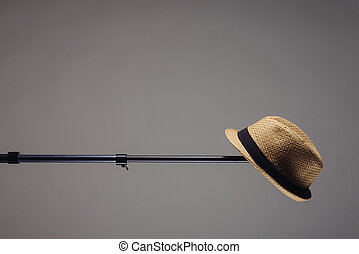 stylish men's straw hat on a photographic stand